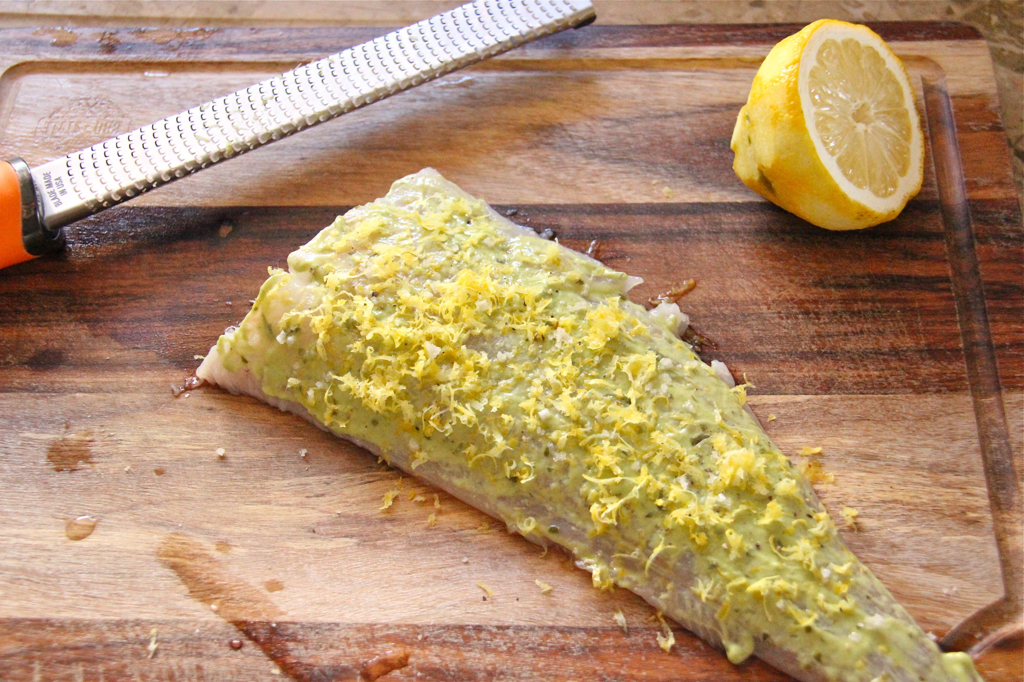 lemon and wholegrain mustard spread on a pollock fillet